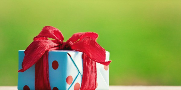 gift box on wooden table on natural sunny background